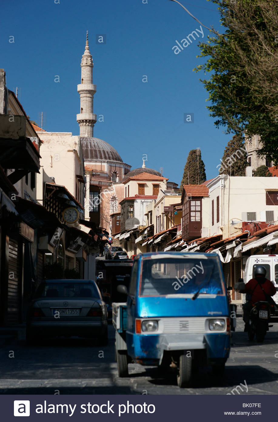 Old Town Rhodes Greece street scene showing Turkish minaret - Stock Image