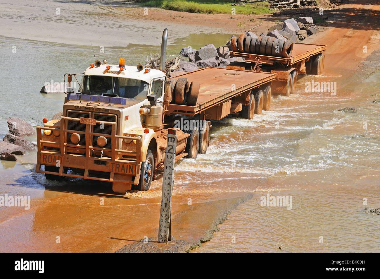 Road train fording East Alligator River Crossing (Cahills Crossing)   Kakadu  National   Park Northern Territory, - Stock Image