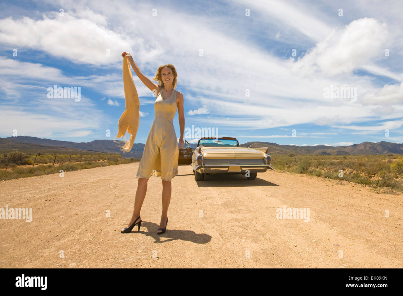 Helpless woman in desert - Stock Image