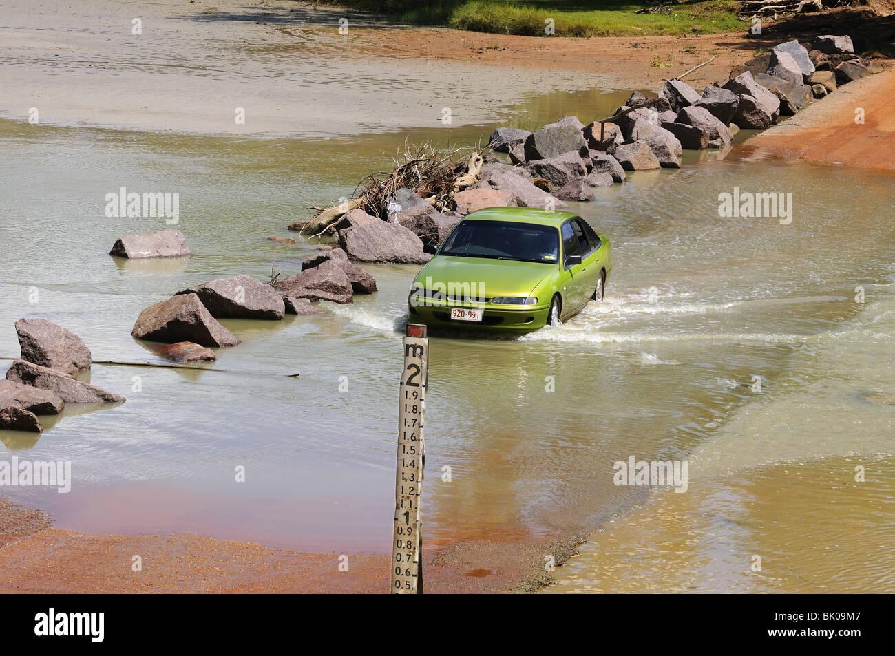 Car fording East Alligator River Crossing (Cahills Crossing)   Kakadu  National   Park Northern Territory, Australia - Stock Image