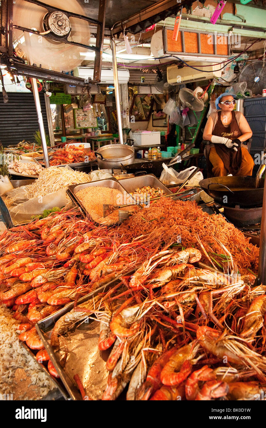 Chatuchak Weekend Market food vendor stall; Bangkok, Thailand. (Largest market in Thailand). - Stock Image