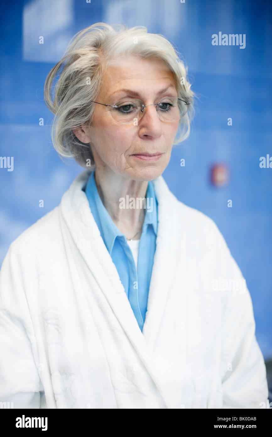 Sad old woman Stock Photo