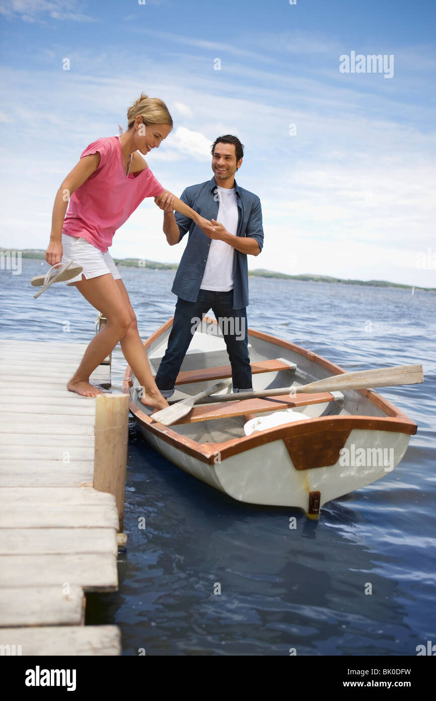 Couple starting a boat trip - Stock Image