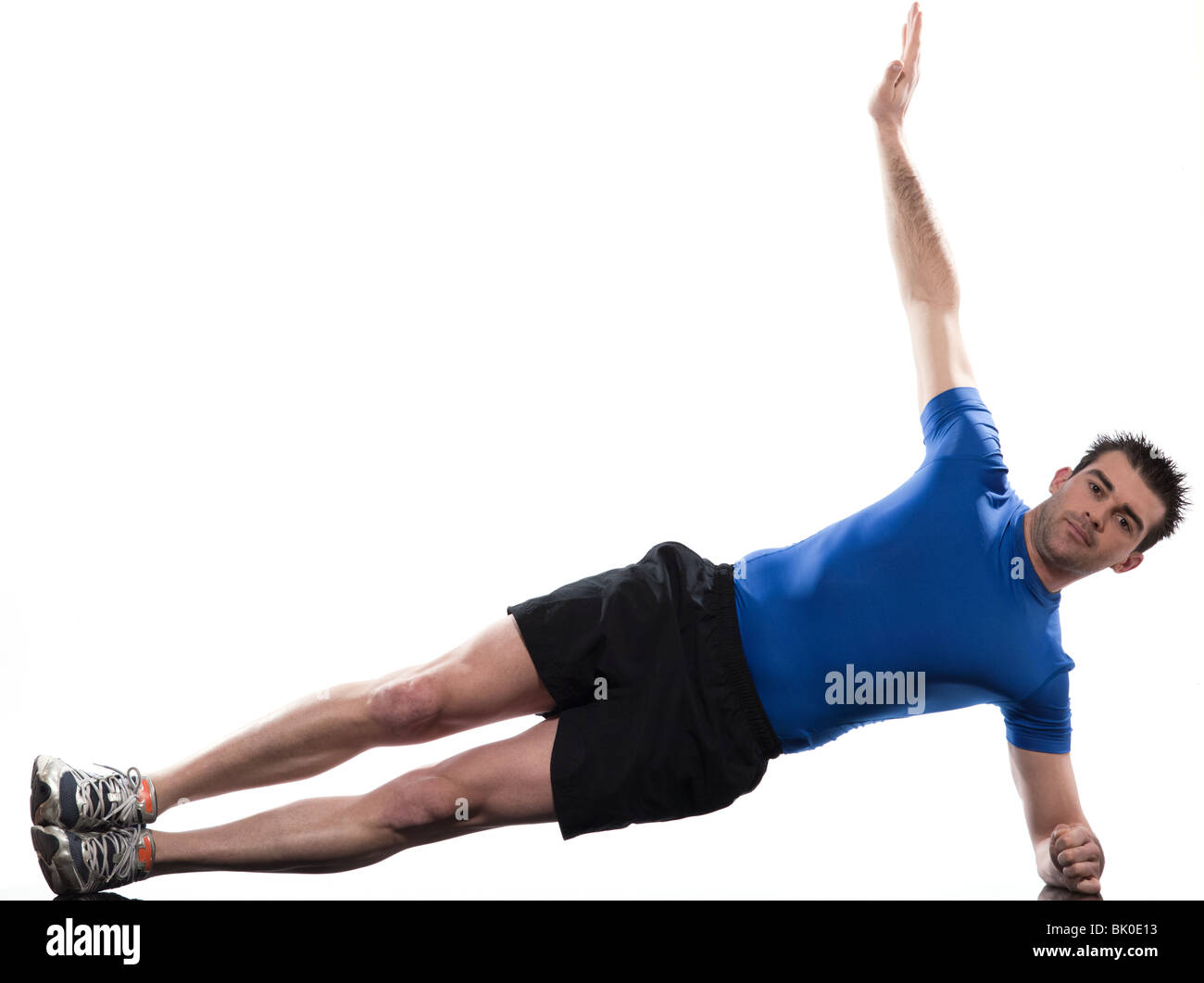 man lying on side  Abdominals workout posture on studio isolated  white background - Stock Image