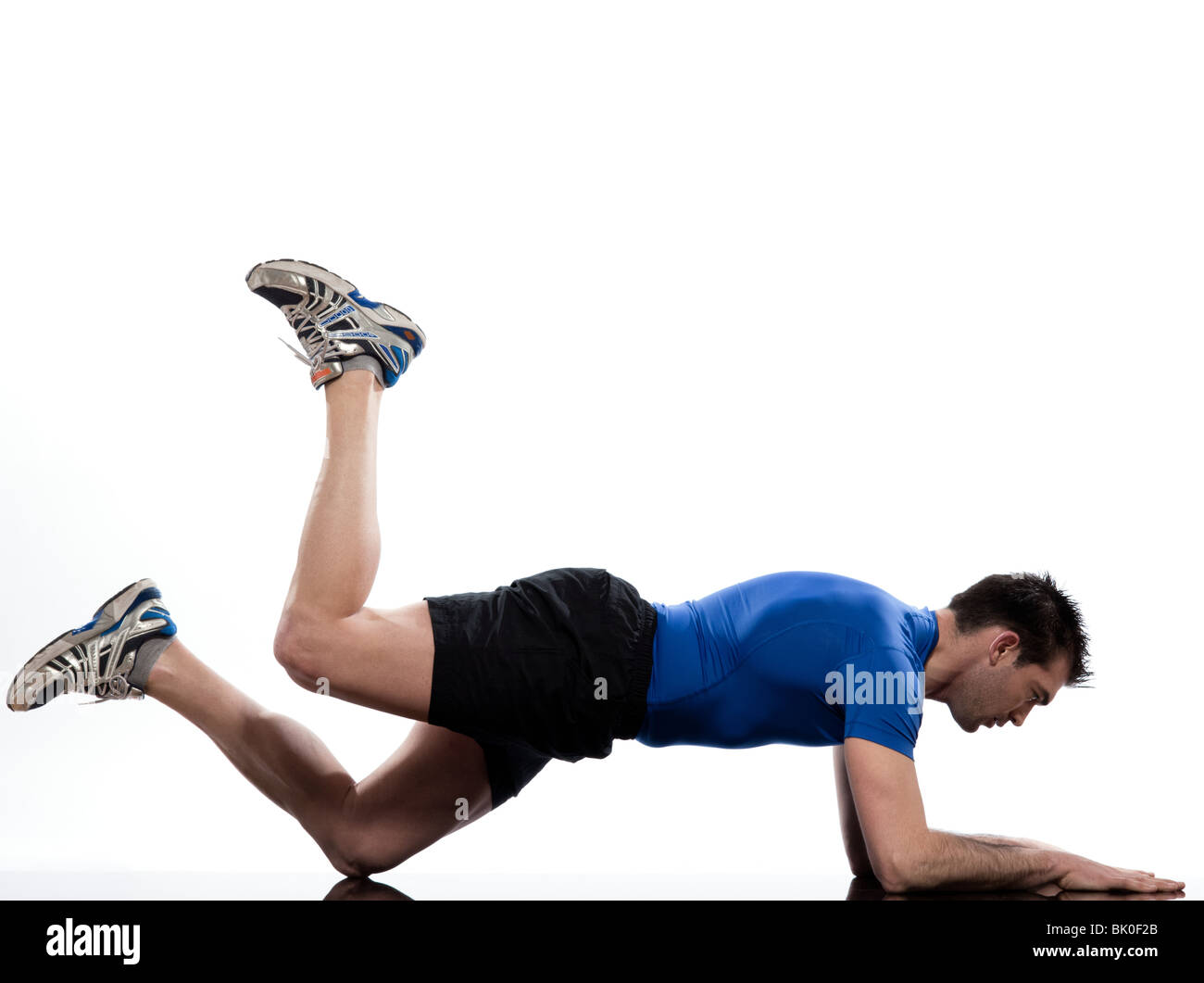 man on Abdominals workout posture on white background. Plank Bent Leg Raise - Stock Image