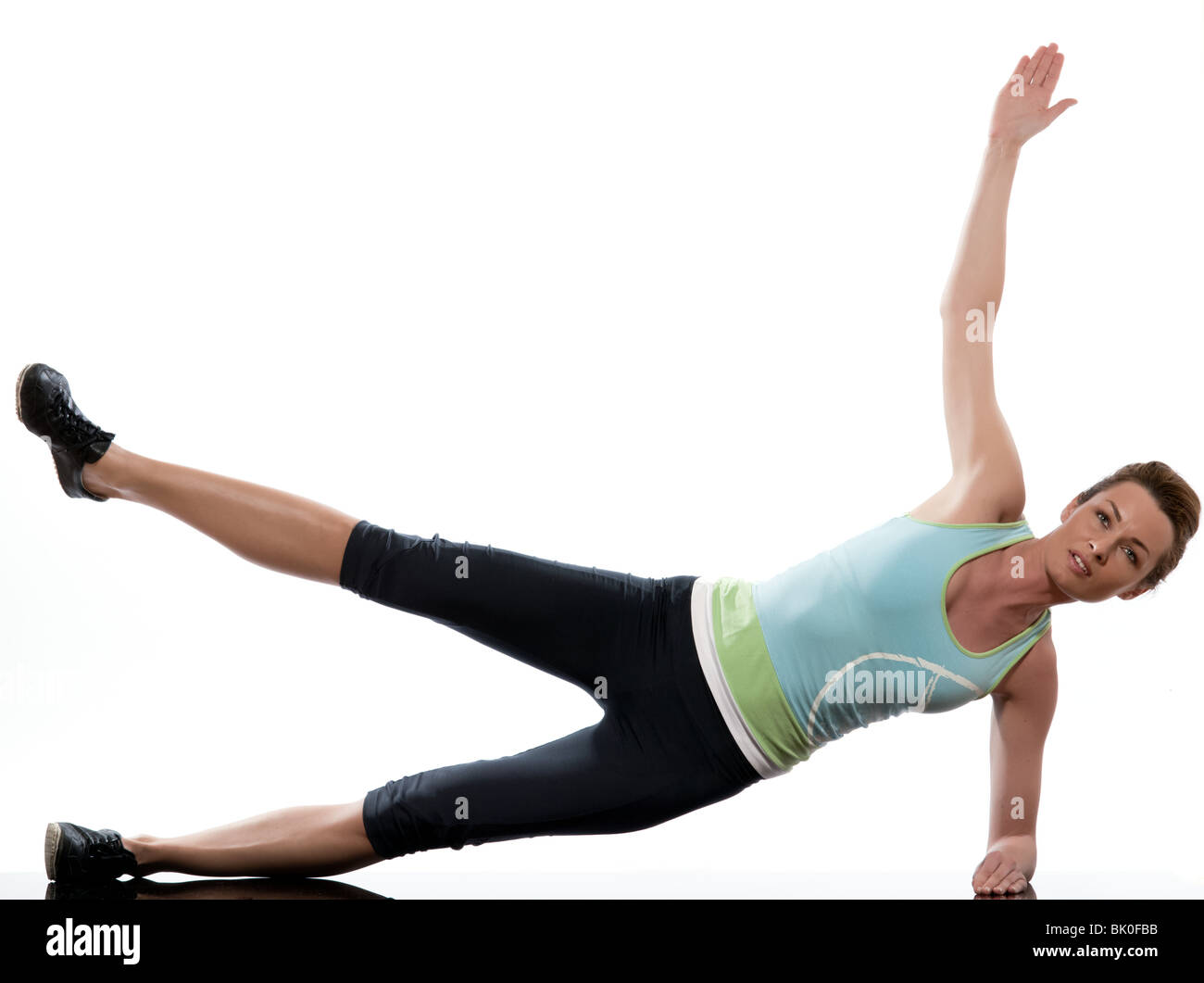 woman on Abdominals workout posture on white background - Stock Image