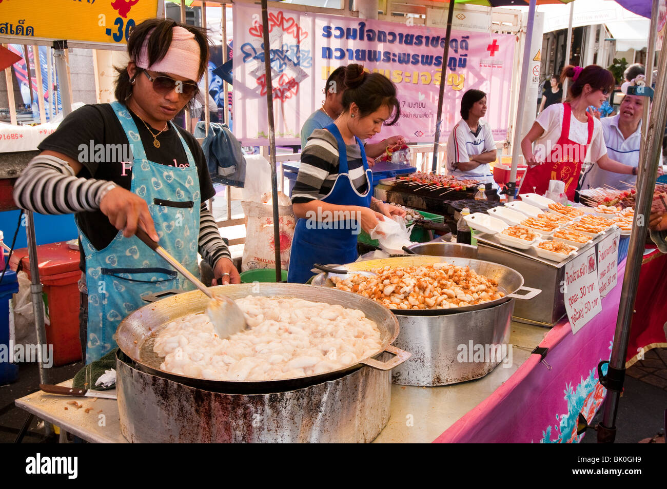 Chatuchak Weekend Market food vendor stall; Bangkok, Thailand. (Largest market in Thailand). - Stock Image