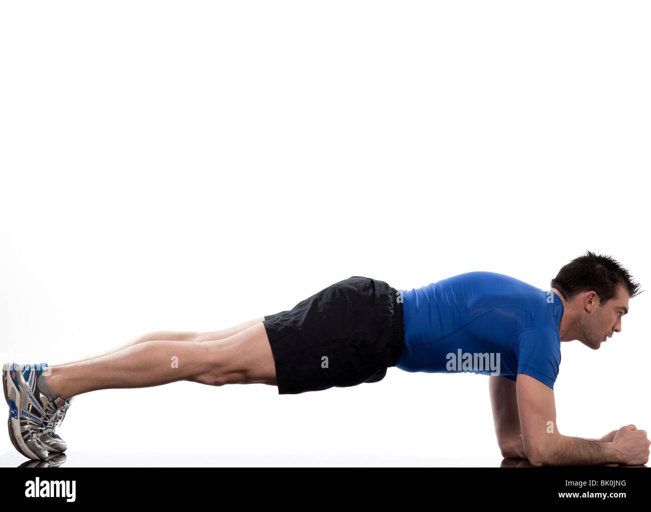 man on Abdominals workout Basic Plank posture on white background - Stock Image