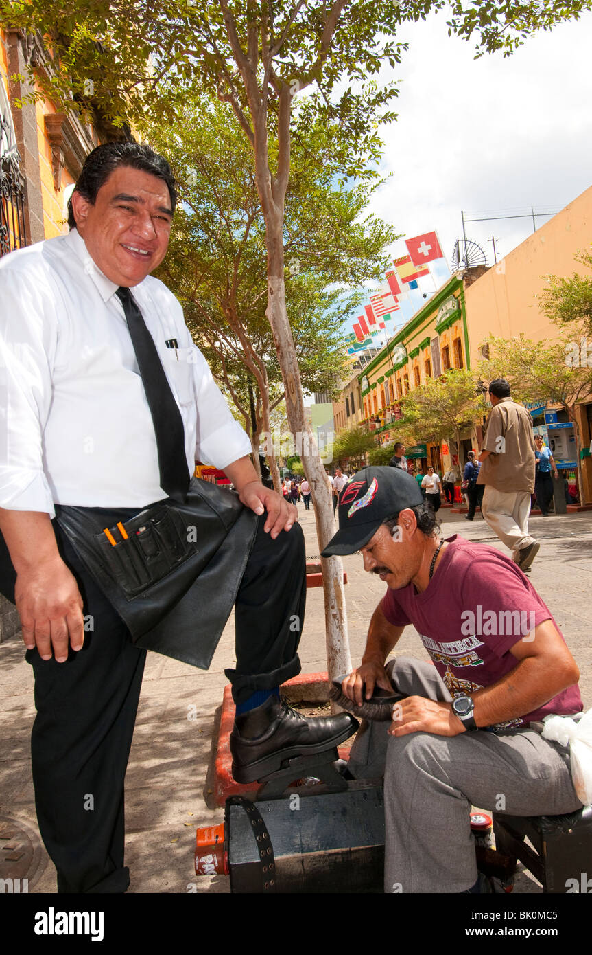 Guadalajara, Mexico, Shoeshine on Morleos Street in historic old town, Liberation Square/Liberacion, Jalisco - Stock Image