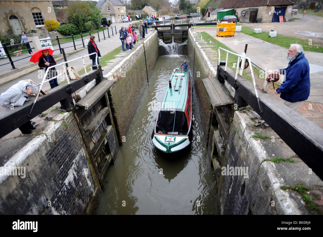 A boat using the lock gates on the Kennet and Avon canal at Bradford on Avon - Stock Image