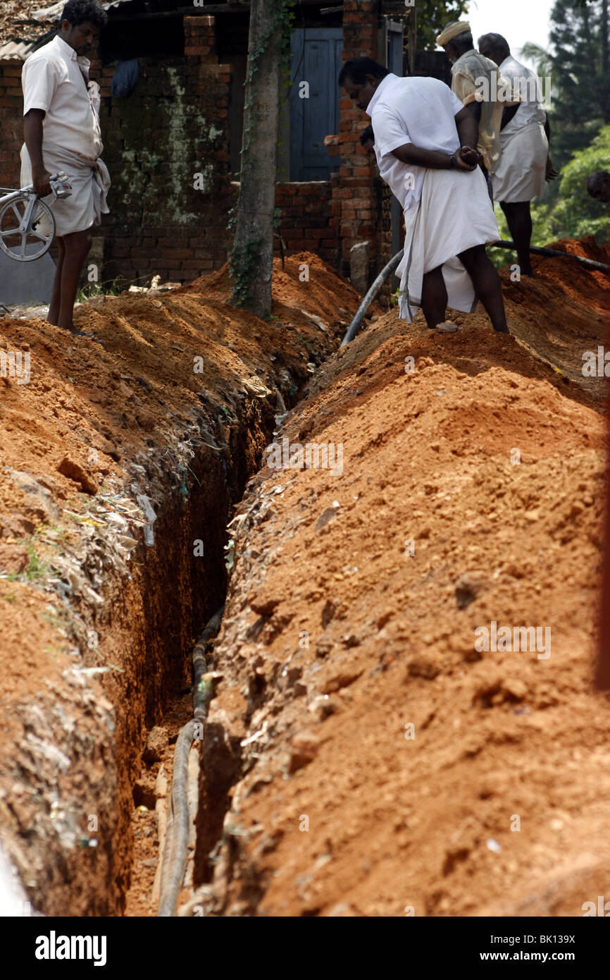 Men At Work Digging A Trench For Laying Telephone Cables