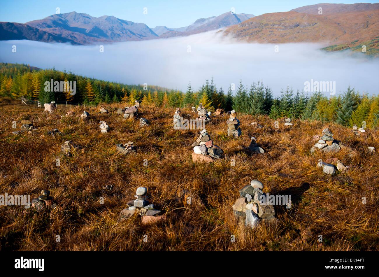 Scotland, pebbles piled together at Glenn Garry - Stock Image