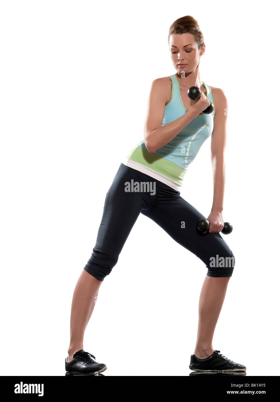 woman doing biceps workout on white isolated background - Stock Image