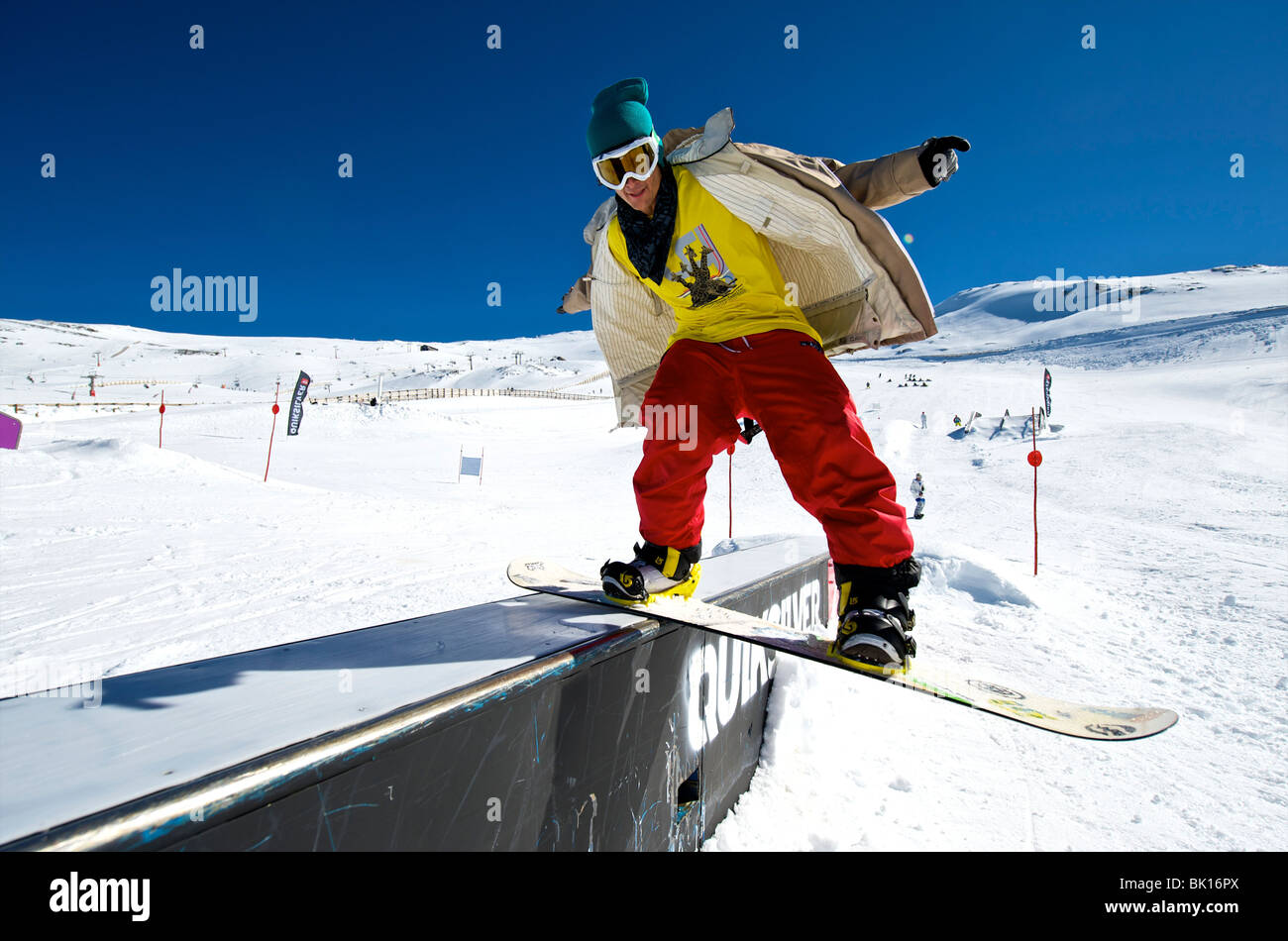 Snowboarder on a slide - Stock Image