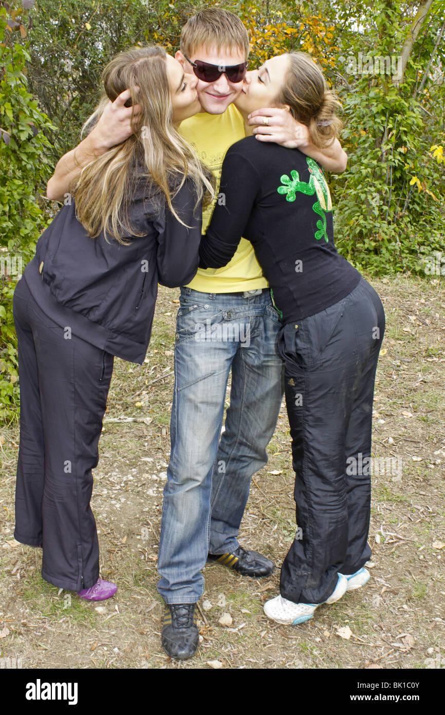Two Women One Man Kiss Stock Photos  Two Women One Man Kiss Stock Images - Alamy-5084