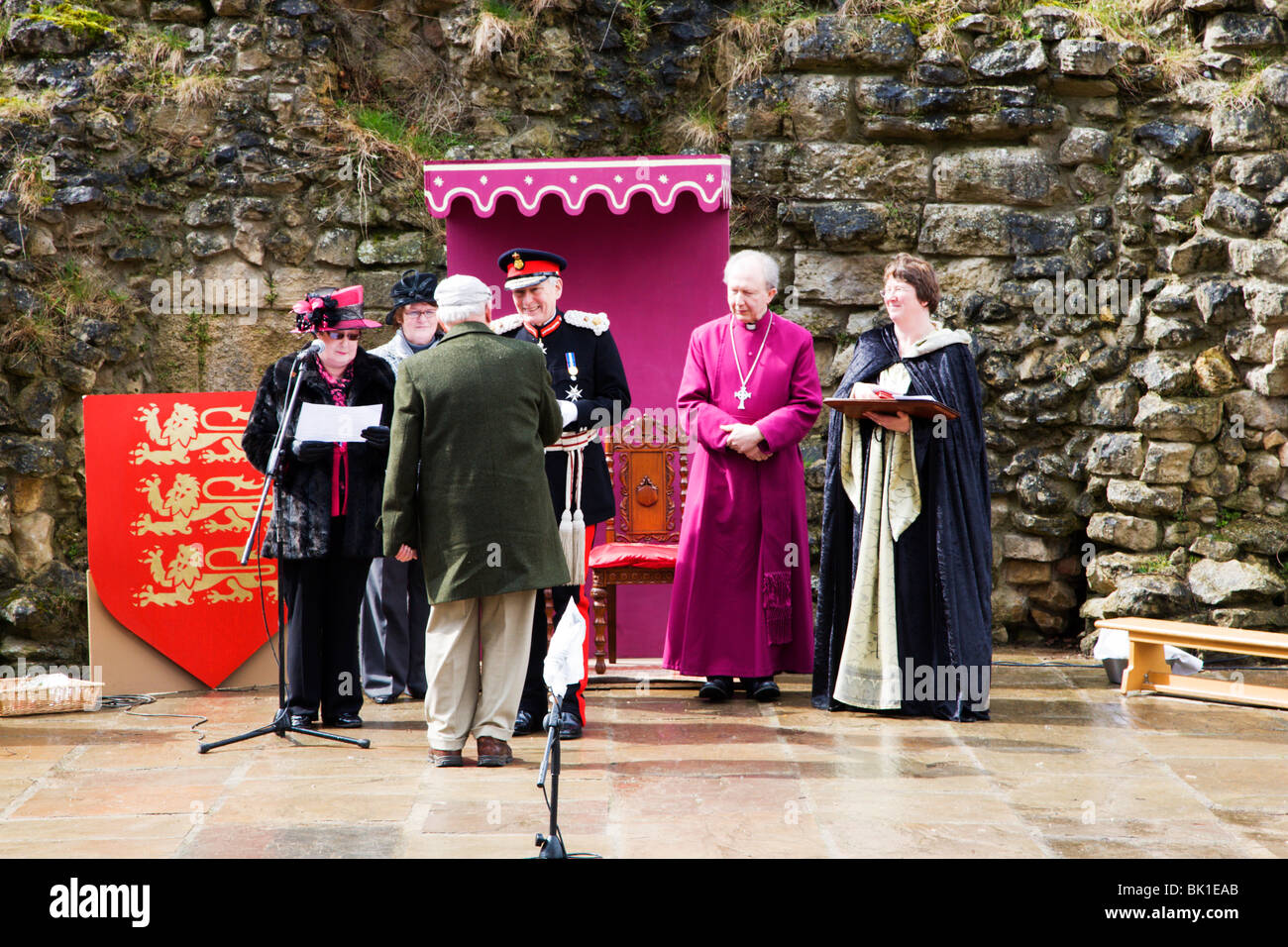 Distribution of the Knaresborough Maundy specially designed coin to 13 residents at Knaresborough Castle - Stock Image