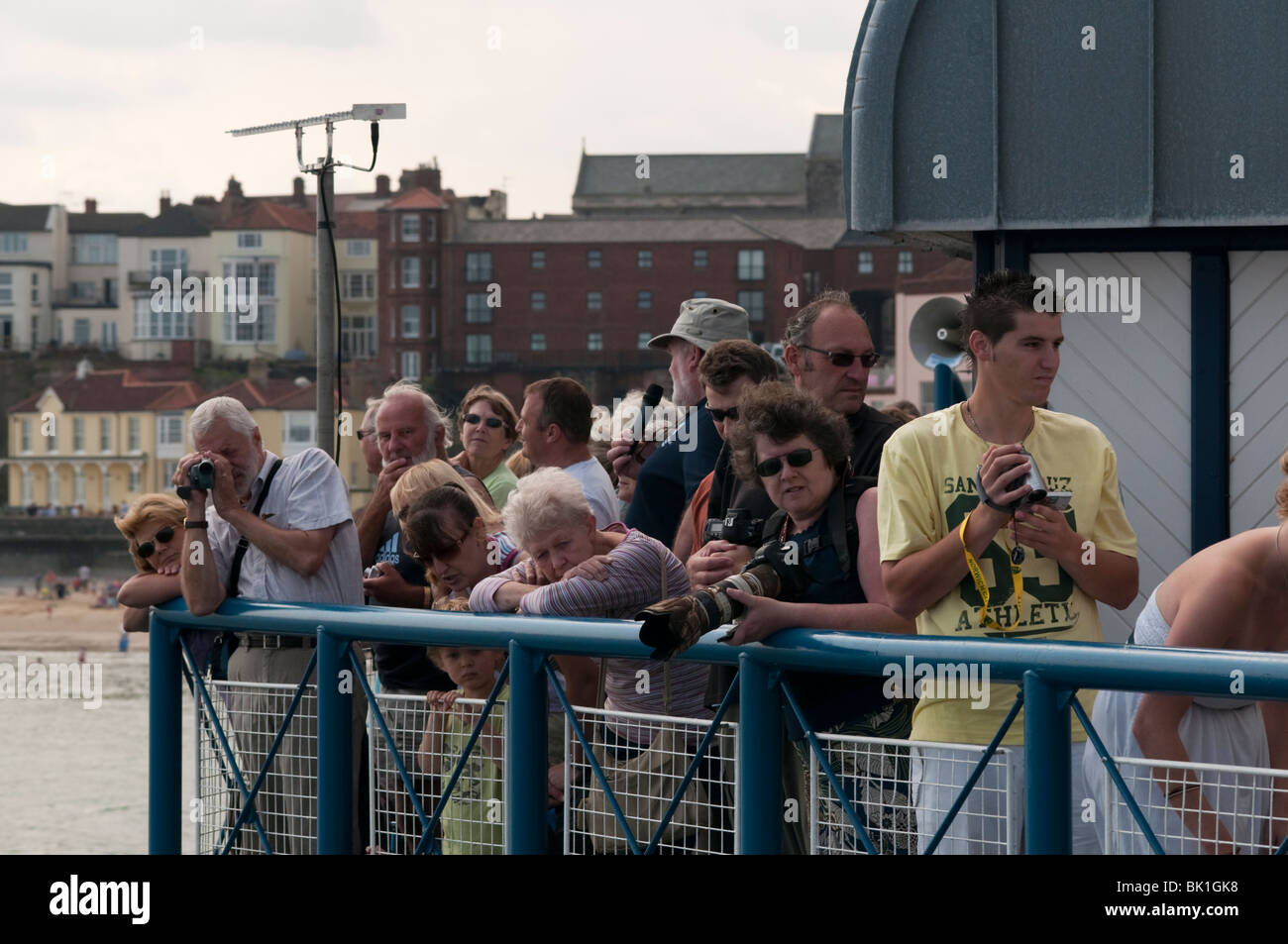 Crowds of onlookers on Cromer pier on Lifeboat Day on Cromer Norfolk East Anglia England - Stock Image