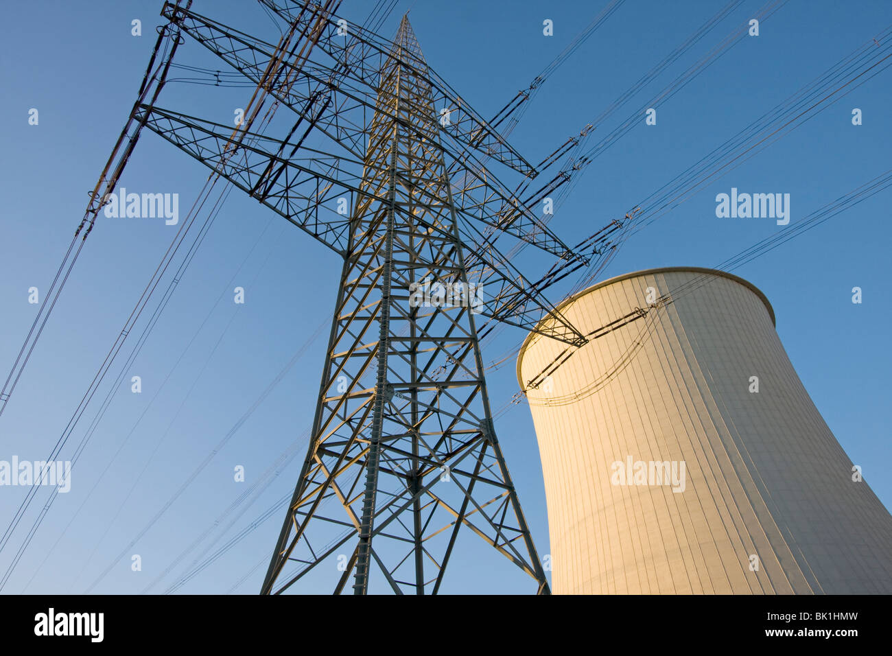 Power pole with cooling tower - Stock Image