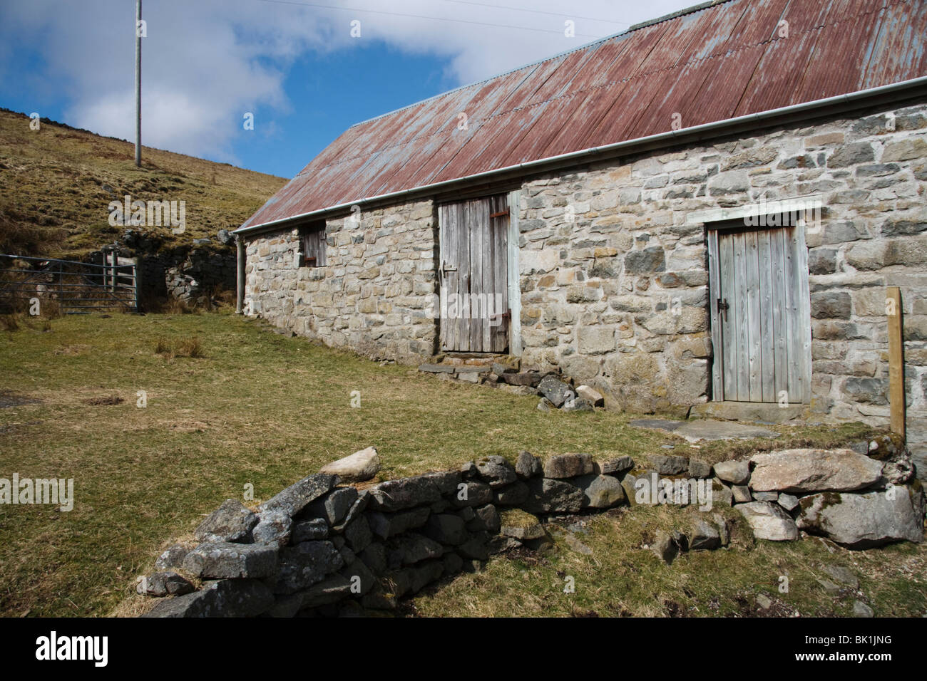 Stone built farm building with tin roof, Mid Wales - Stock Image