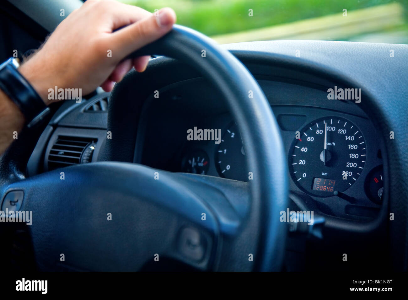 Hand of man driving a car - Stock Image