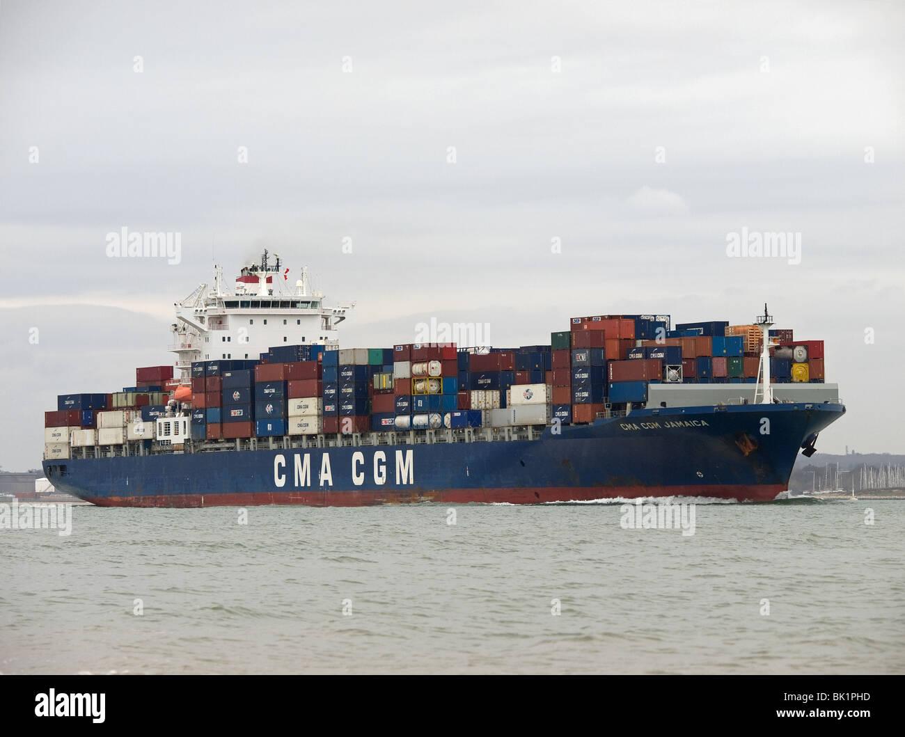 Container ship CMA CGM Jamaica leaving Southampton UK - Stock Image