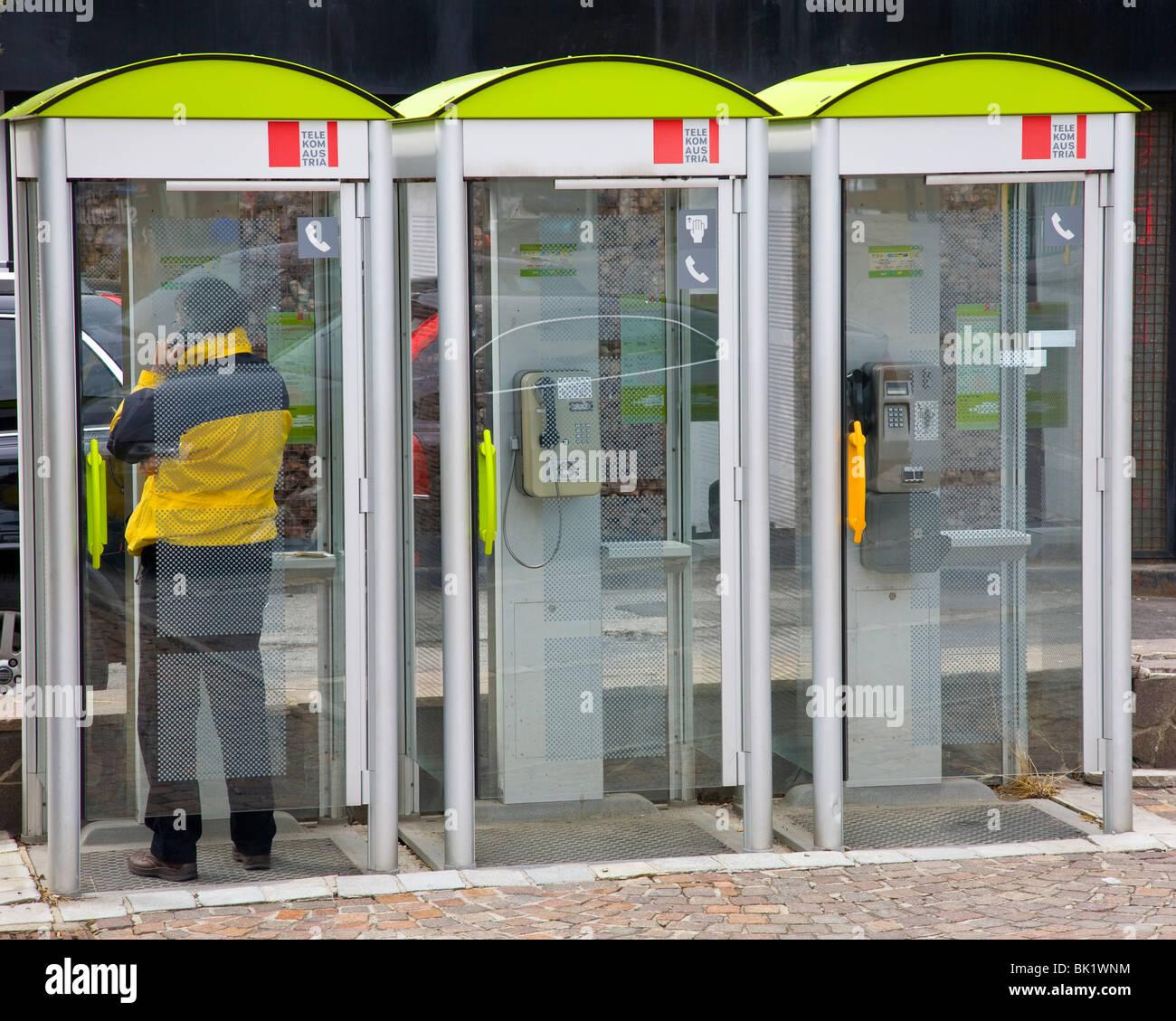 Three telephone kiosks - Stock Image