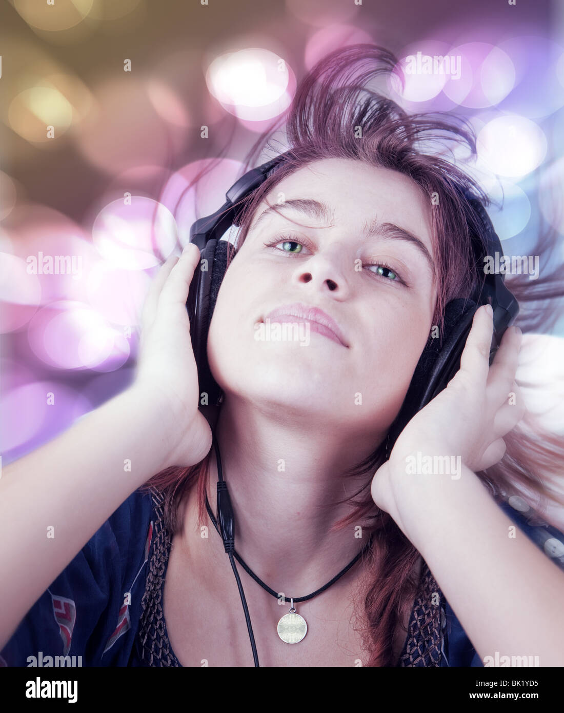 Active young teen woman listening modern music - Stock Image