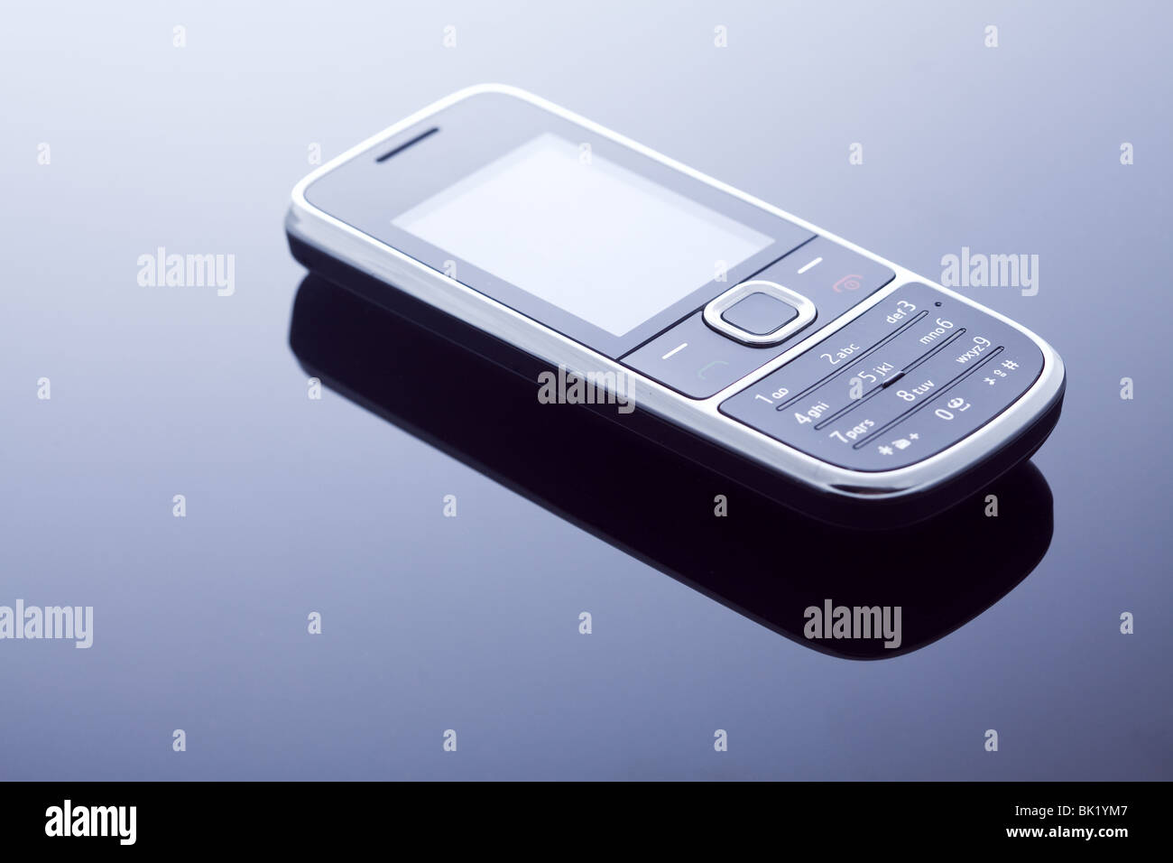 Obsolete outdated old model mobile phone with keypad - Stock Image