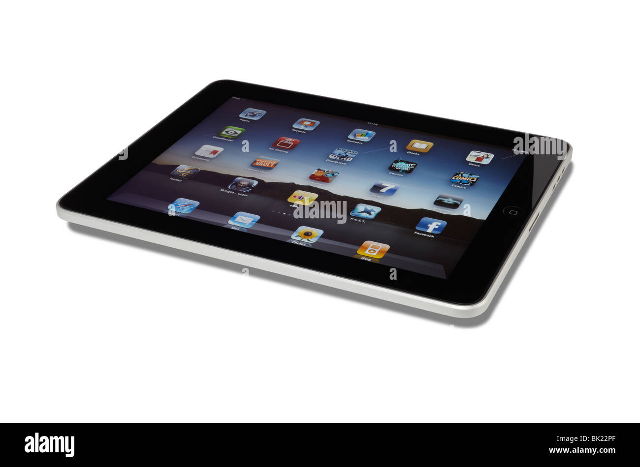Apple iPad in landscape orientation cut out on a white background with shadow and clipping path - Stock Image