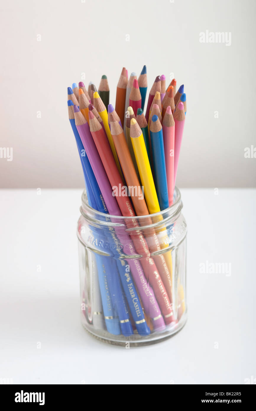 A  pot of colouring pencils - Stock Image