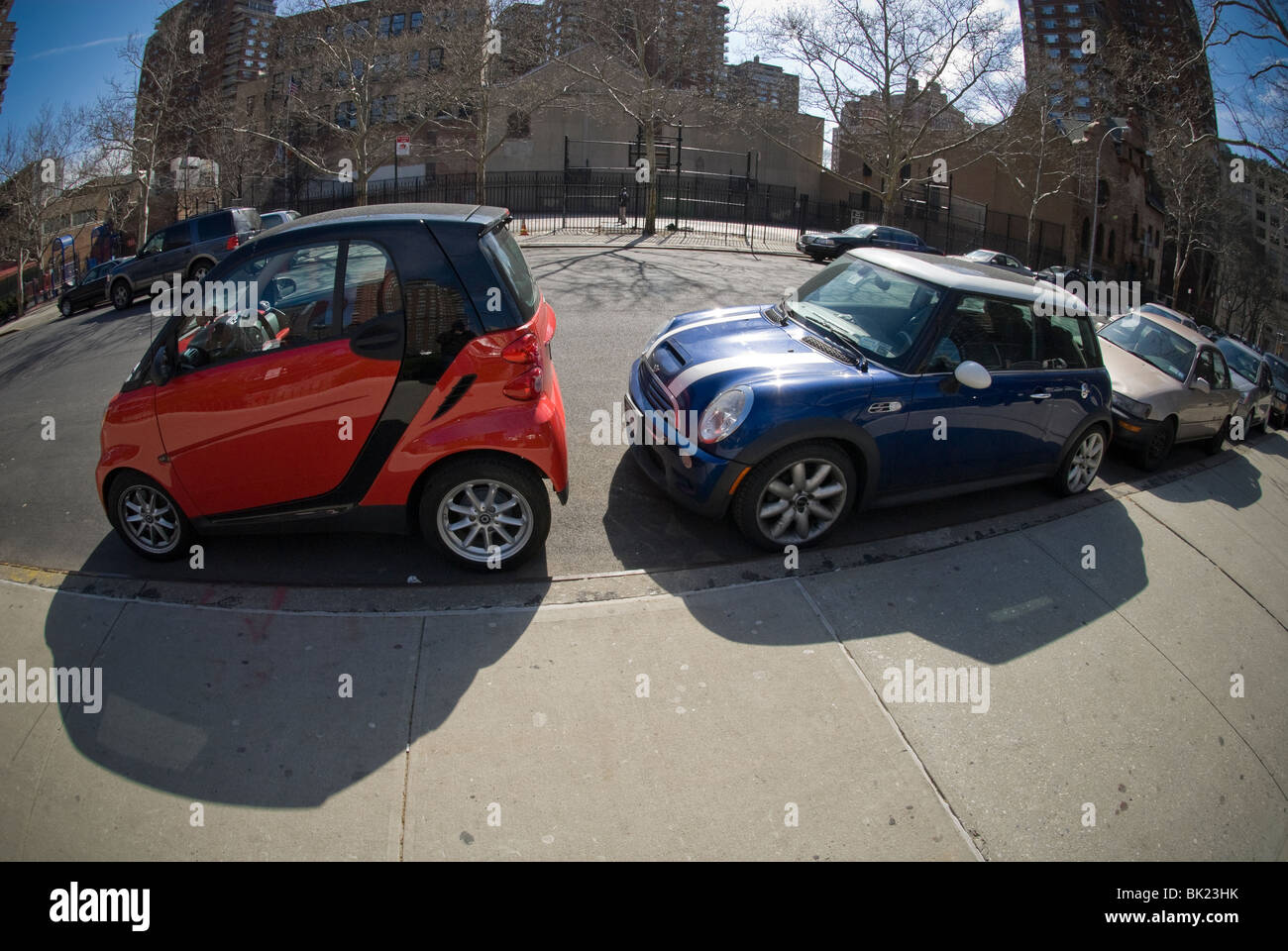A two-seat Smart car, left, manufactured by Daimler and a Mini ...