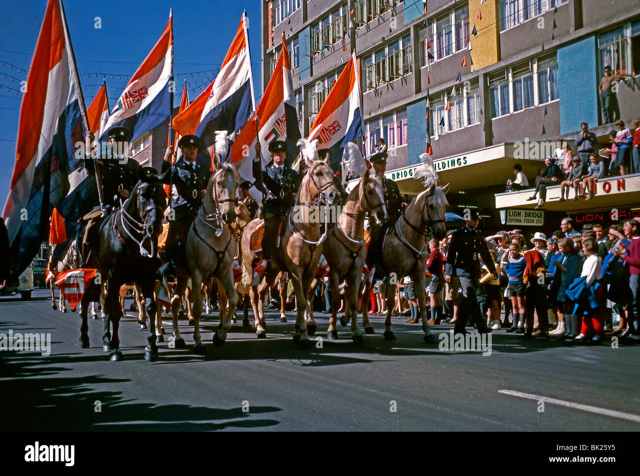 Parade with mounted policemen on horseback carrying the national flag during the apartheid era, Durban, South Africa, - Stock Image