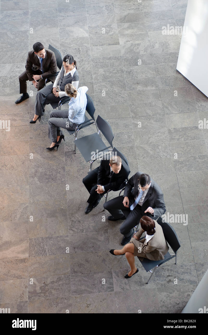 Two groups of business people discussing - Stock Image
