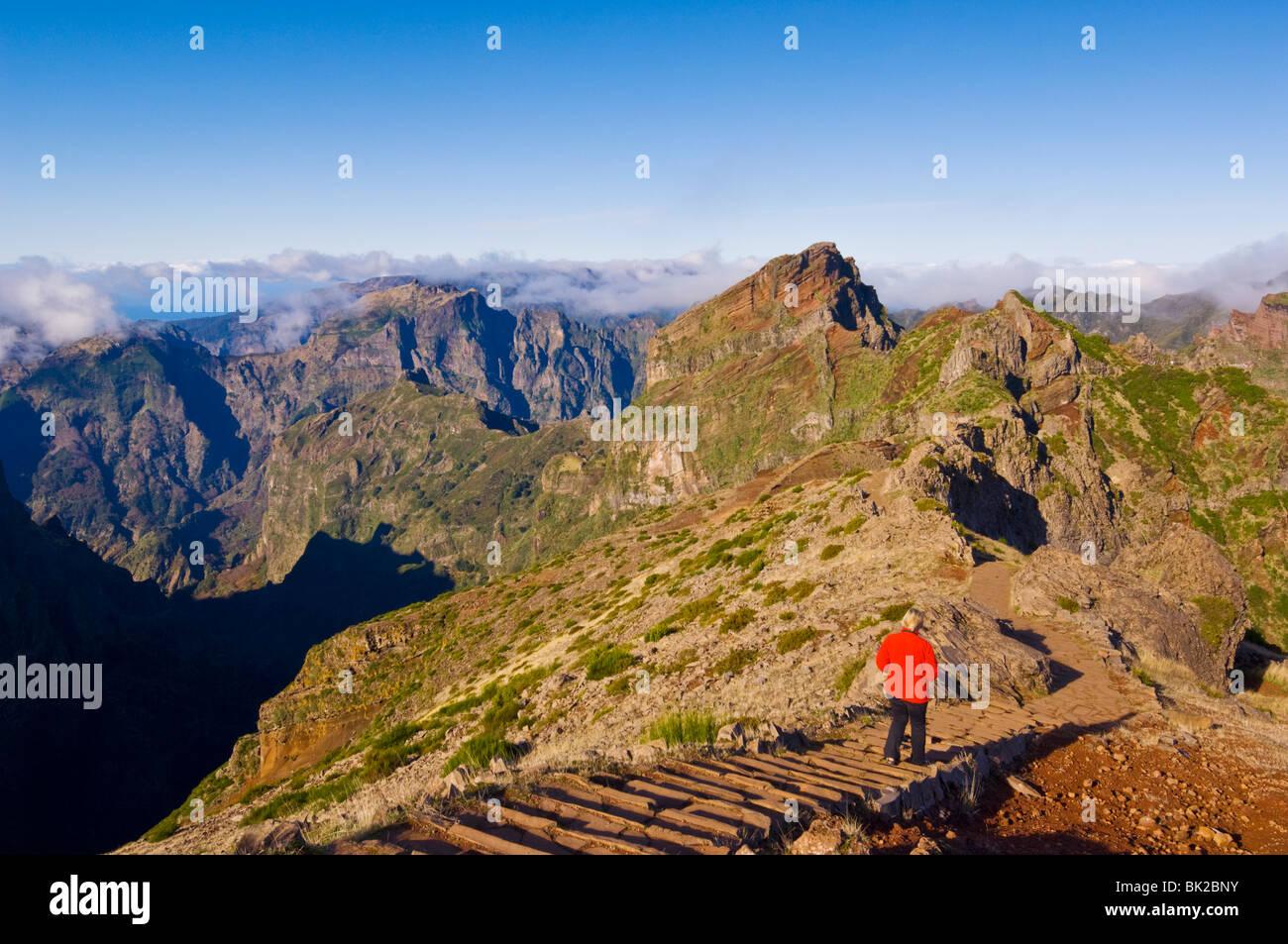 tourist walking through the Volcanic landscape of the Pico do Ariero, Central Madeira, Portugal, EU, Europe - Stock Image