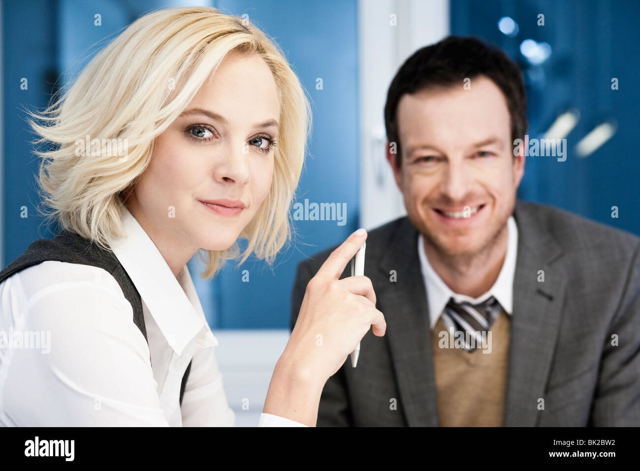 Business people looking at viewer - Stock Image