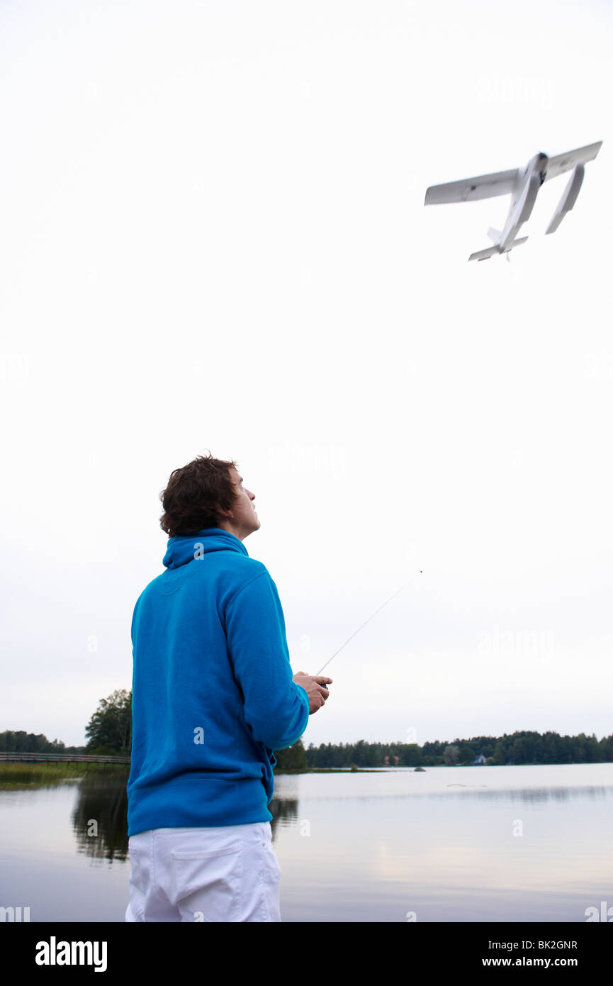 Man with a remote-controlled plane - Stock Image