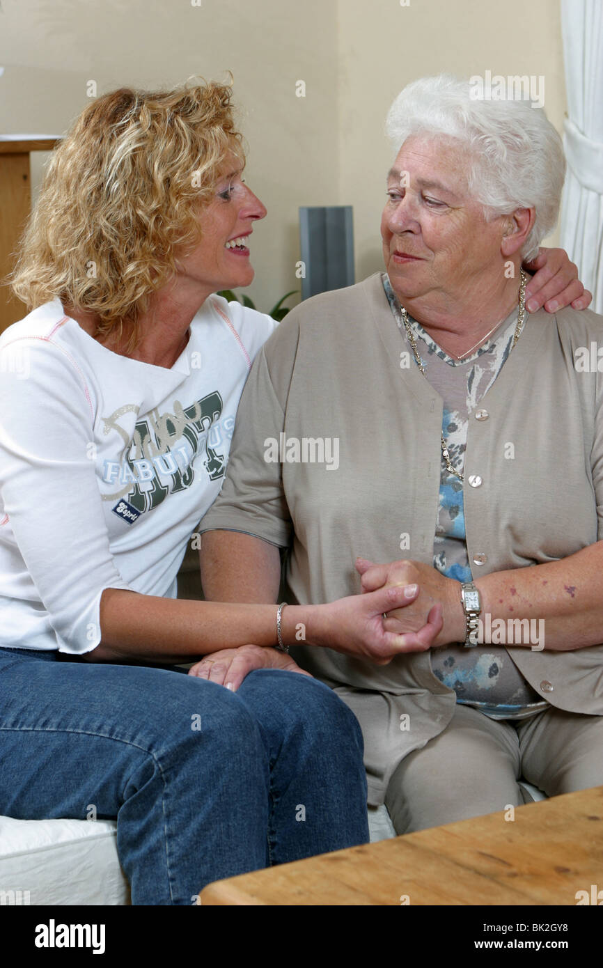 Grown up daughter visiting old mother in oap housing facility - Stock Image