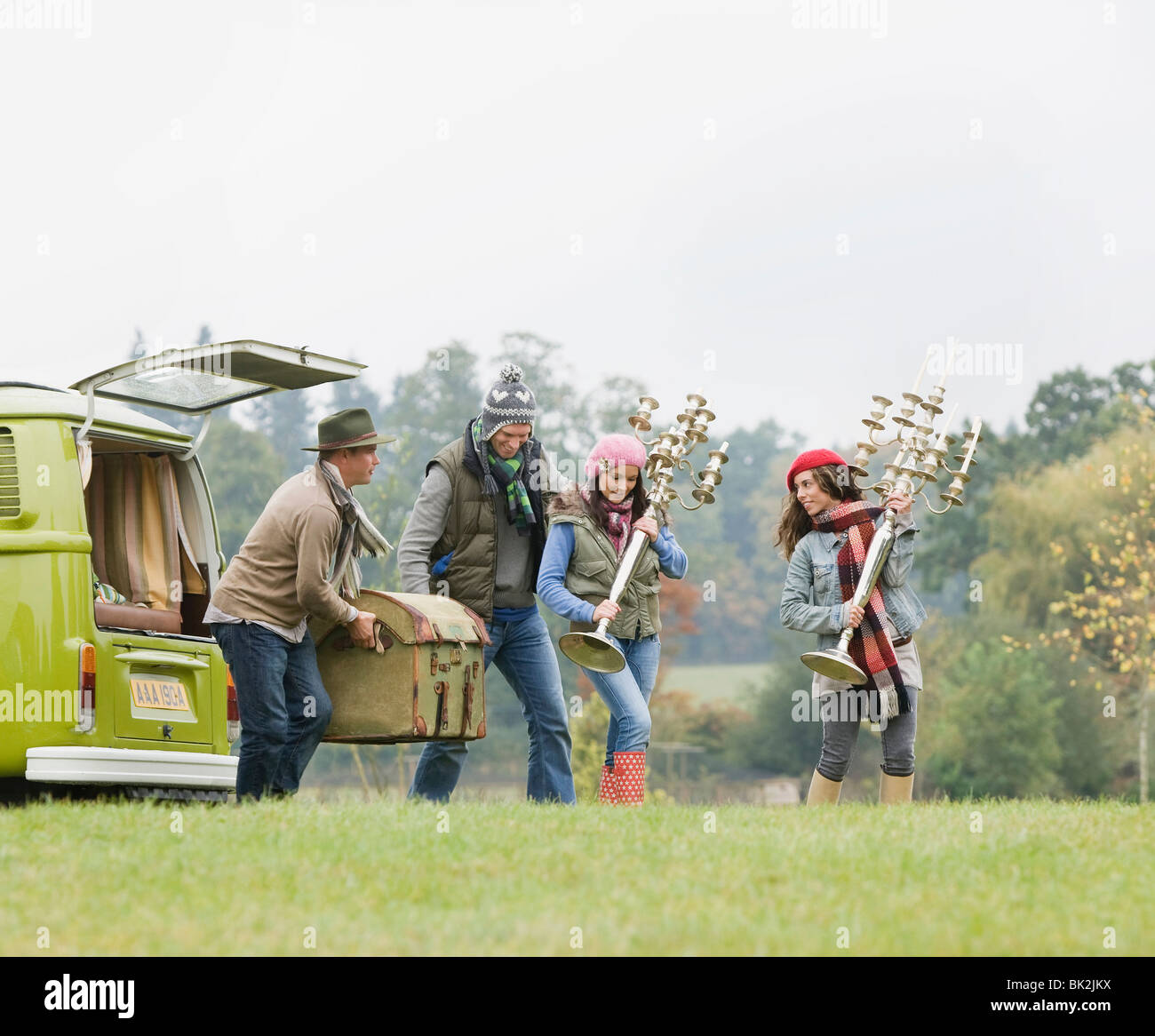 People unloading things from camping van Stock Photo