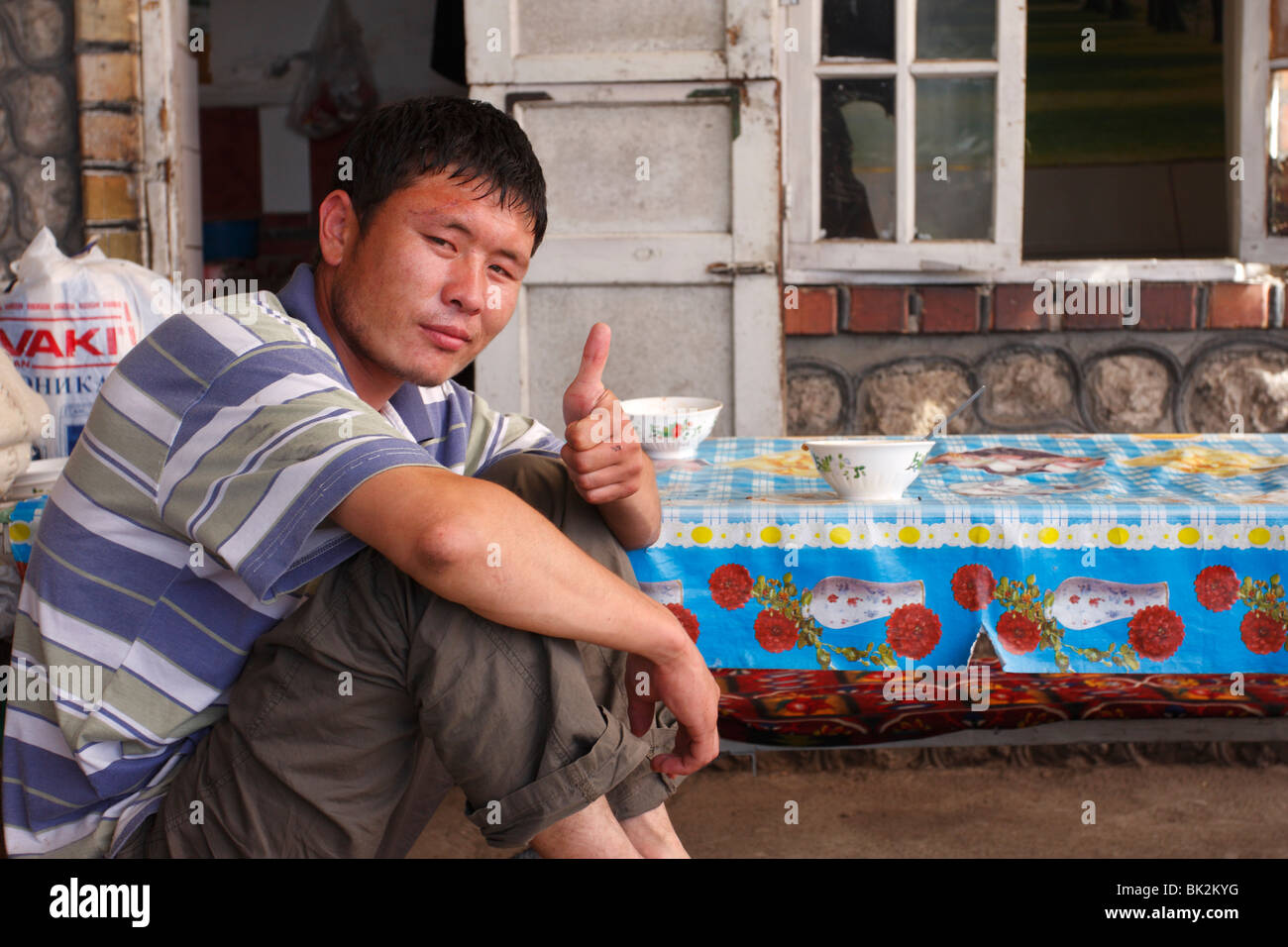 A man showing his thumbs up, Kyrgyzstan - Stock Image