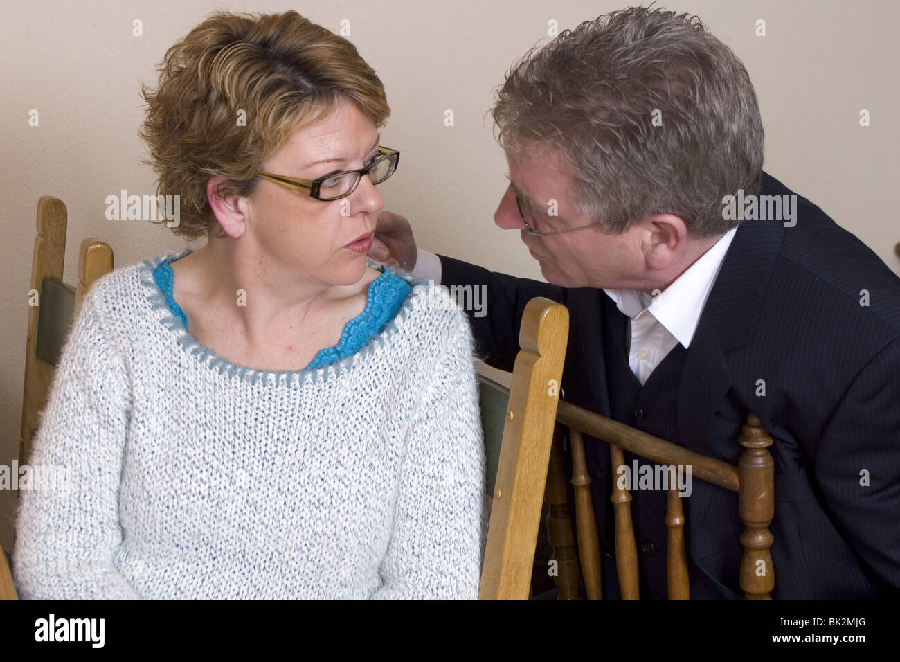Adult couple serious conversation Stock Photo