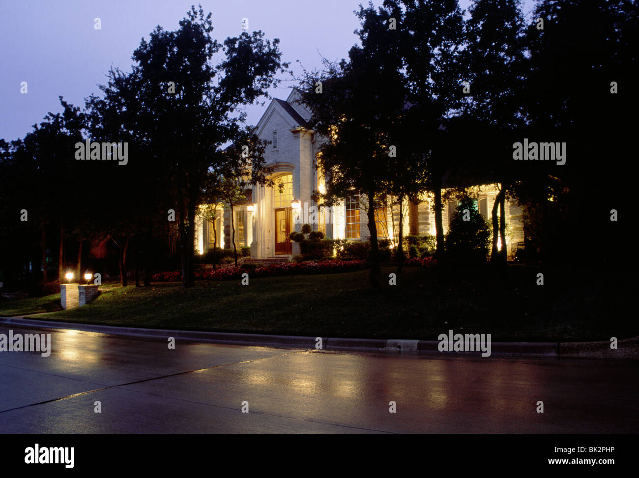 House Exterior in the Rain at Night - Stock Image