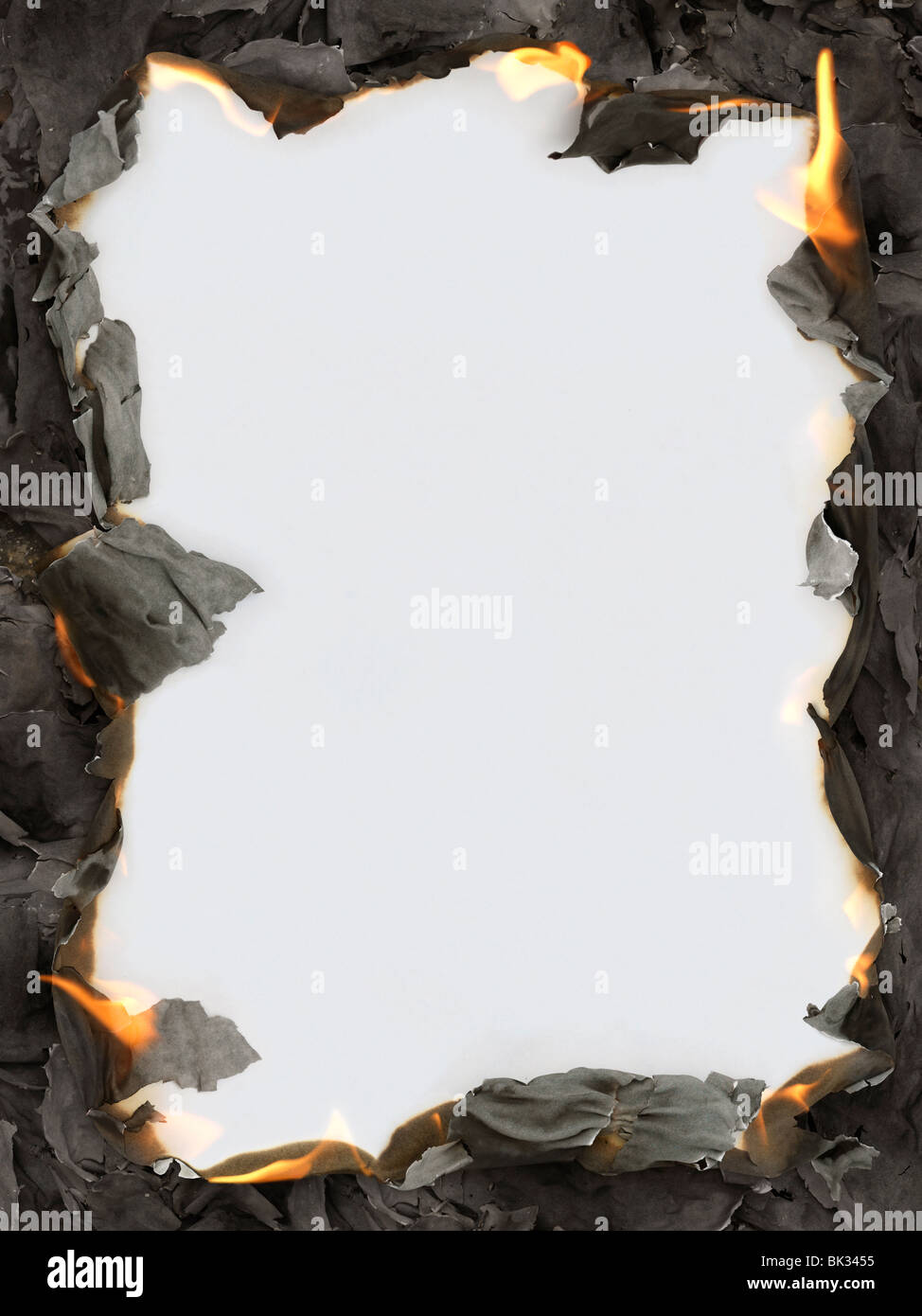 Burning paper ashes revealing blank white background making a frame ...