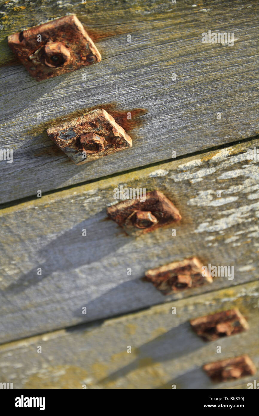 Rusty nuts, bolts and washers on a sea defence groyne in East Sussex, England. Stock Photo