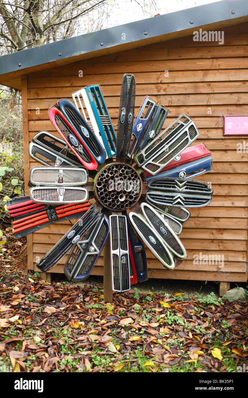 Sculpture made from scrap car parts, on display at an urban nature reserve. Powys, Wales. Stock Photo