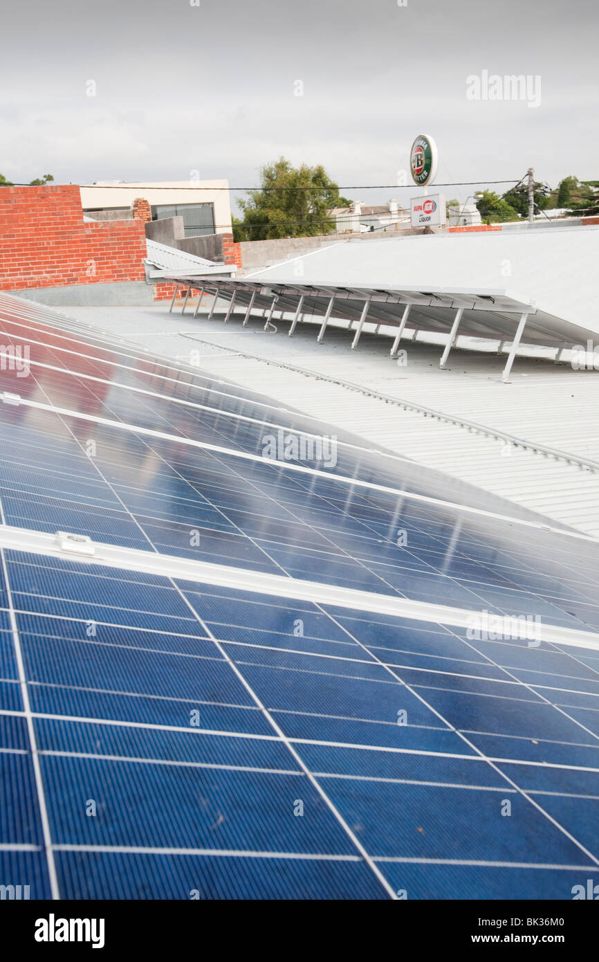 Solar panels on the roof, power the Super AIG Supermarket in Hawthorn, Melbourne, Victoria, Australia. - Stock Image