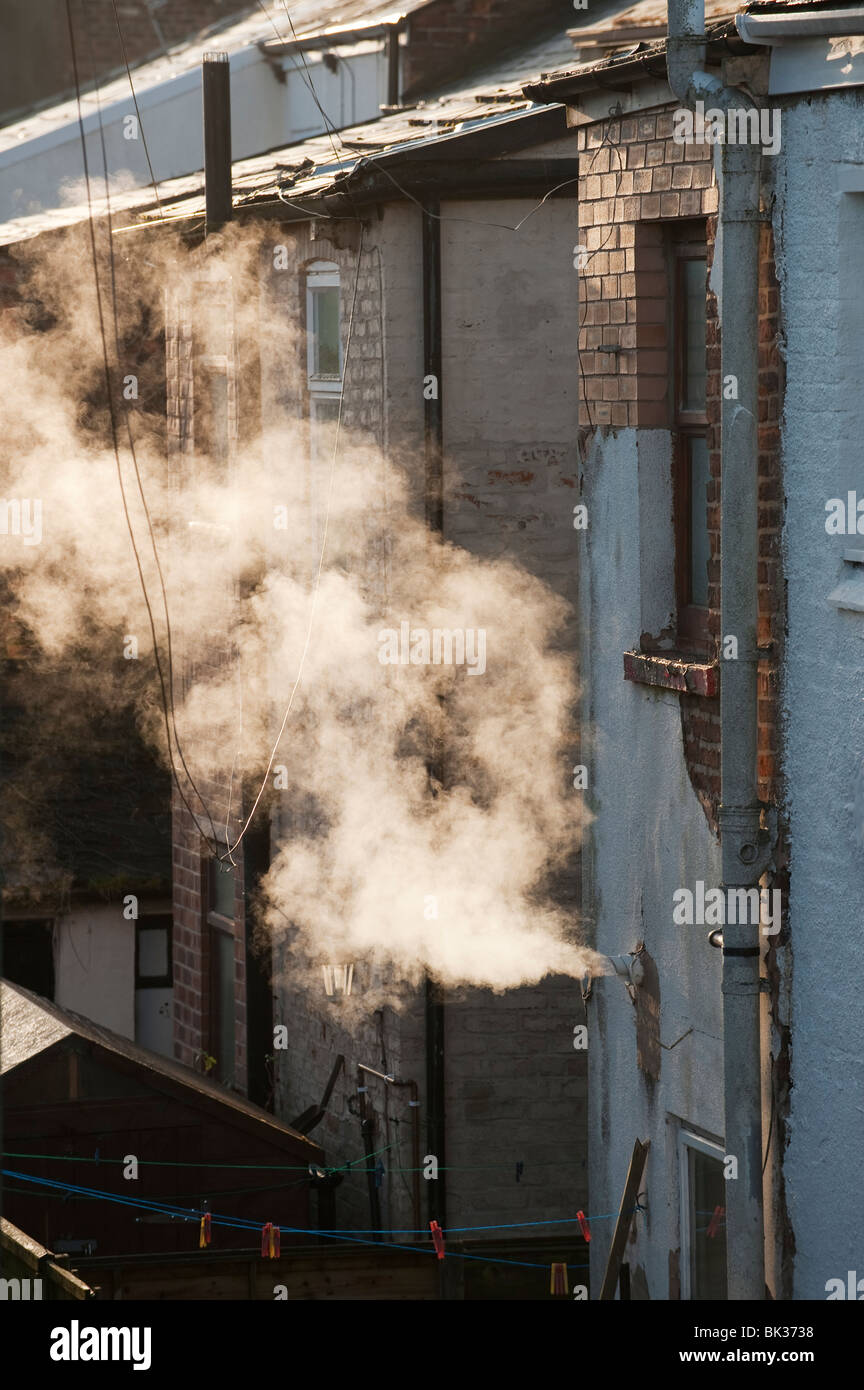 Steam from central heating vent, Greater Manchester, UK - Stock Image
