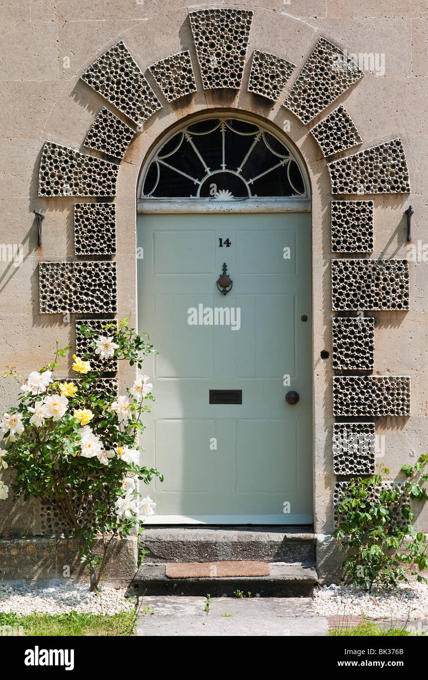 Ornate domestic front doorway design photographed from public road Stock Photo