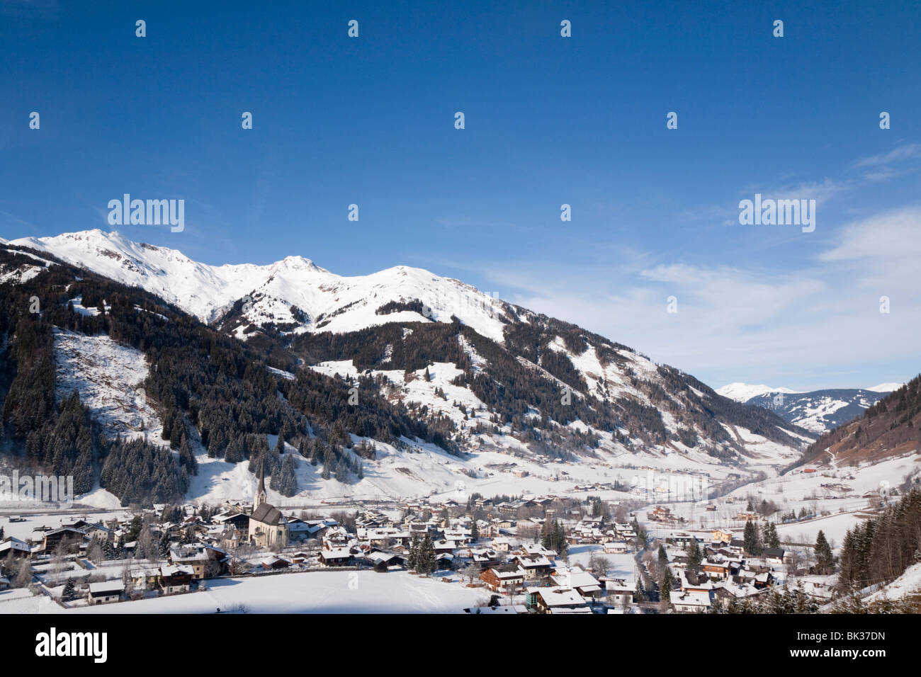 Alpine ski resort in Austrian Alps with snow in Rauriser Sonnen Valley and on Sonniblick Mountains in winter, Rauris, Stock Photo