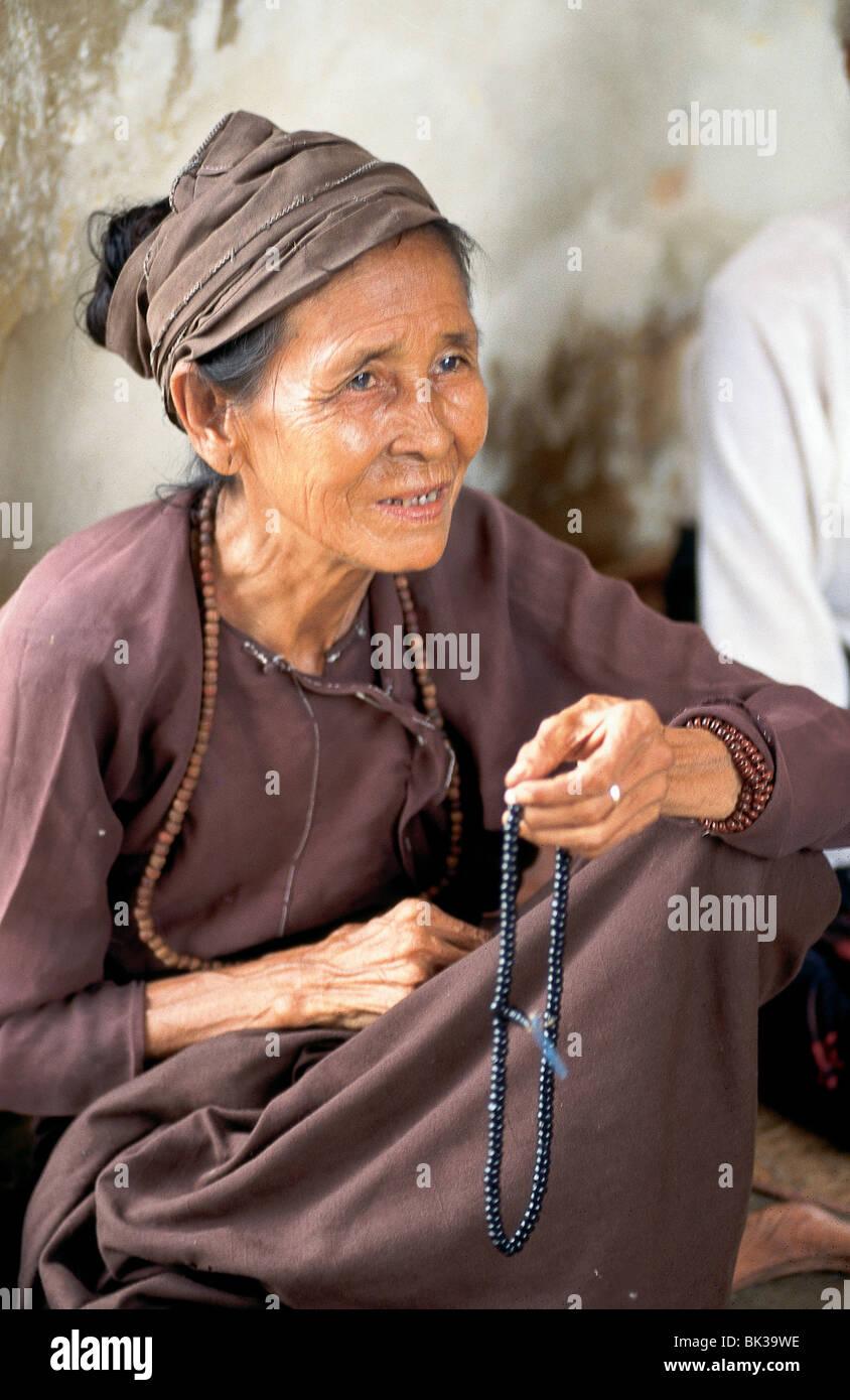 Woman holding beaded necklace, Bagan, Myanmar - Stock Image