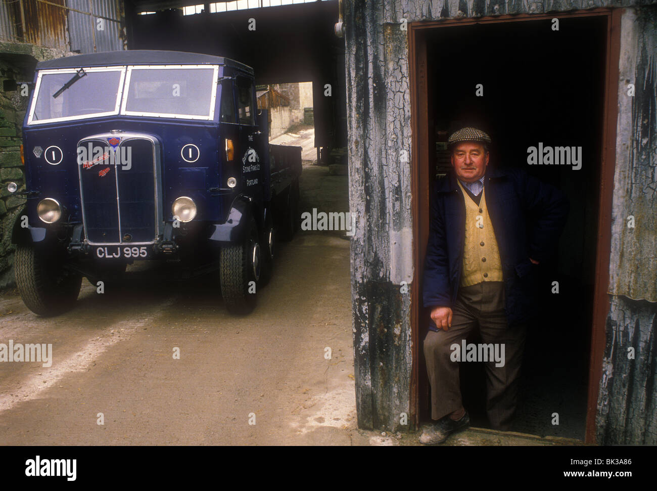 Driver by his 1936 AEC Mammoth Major eight wheeler truck - Stock Image
